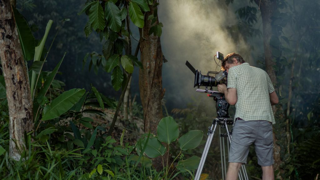 Behind-the-scenes shot of our cameraman capturing off-road driving scenes in the Malaysian wilderness