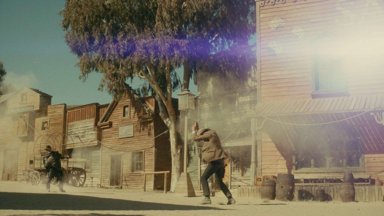Doctor Who visual effects shot of a battle in a western town, sand blowing around