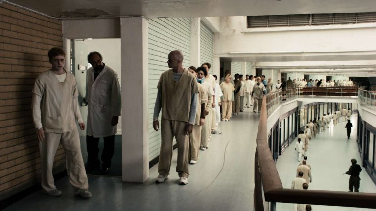 'In the flesh' visual effects shot of zombie patients queuing up outside a medical room