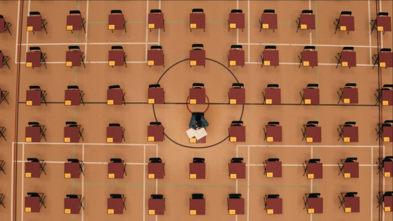 A top-down visual effects shot of an infinite exam hall