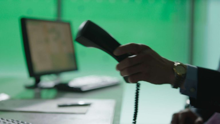 One Child - close-up of telephone with green screen background (before)