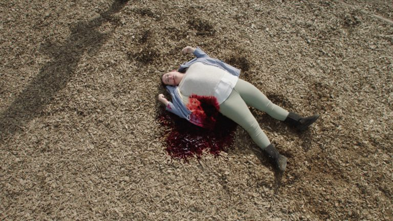 'Paranoid' visual effects shot of a girl lying wounded on a woodland floor