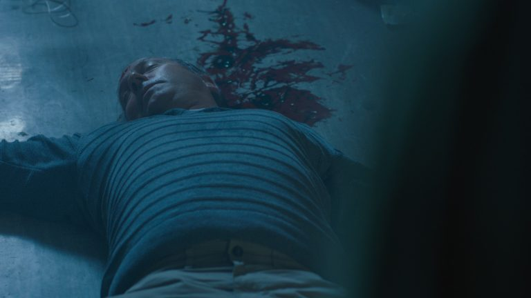 'Paranoid' visual effects shot of a pain laid on the floor with a severe head injury