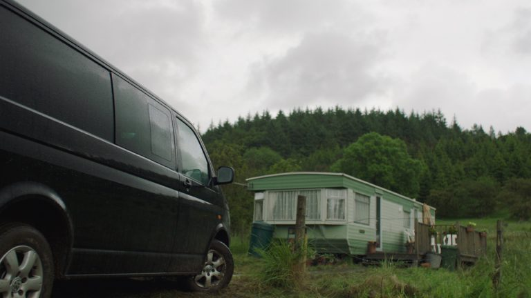 Image of a van and static caravan in rural setting