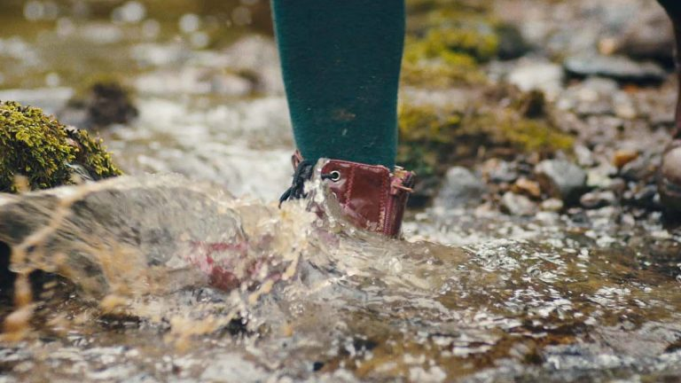 Shot of a girl walking through a river in boots from the Woodland Trust TV ad