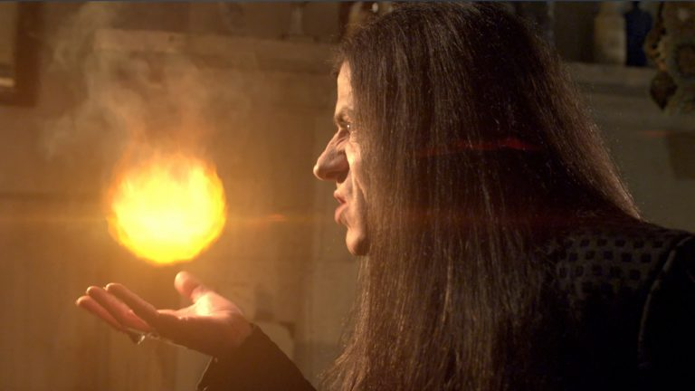 Young Dracula visual effects shot of a long-haired man holding a fireball