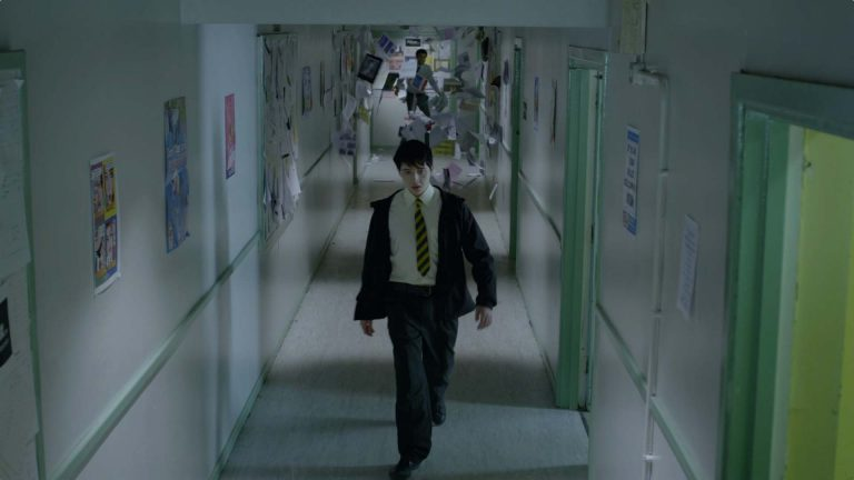 Young Dracula visual effects shot of a boy walking down a corridor, followed by flying paper