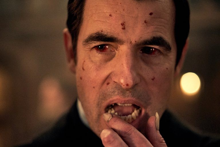 Image of Dracula with face covered in bloody