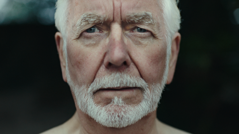 A close-up of elderly gentleman looking apprehensive