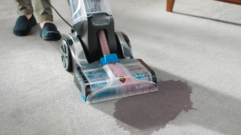 The Vax Platinum Smartwash cleaning up a spilt smoothie